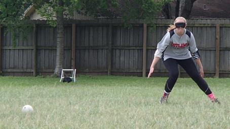 Hillary House readies herself in fielding stance to catch an incoming ball.