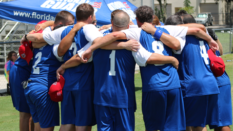 A team stands together in a huddle.