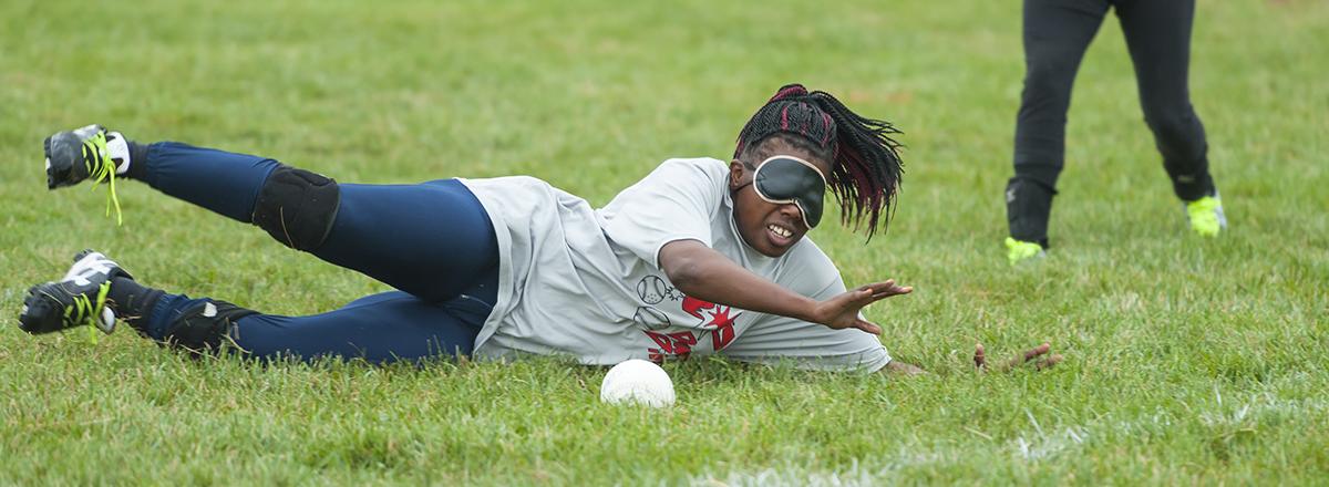 Kalari Girtely Jackson dives to block a ball.