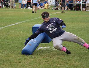 Erik Rodriguez taking down a beep baseball buzzing base.